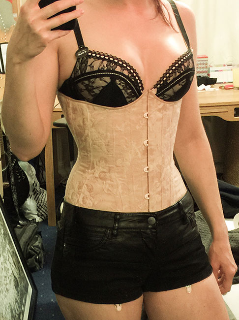 Corset making complete! Front view with suspenders under shorts
